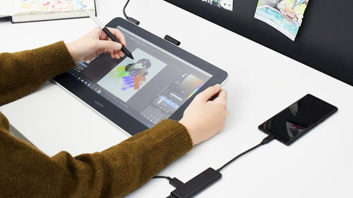 A man drawing a woman on Wacom One Pen Display Tablet