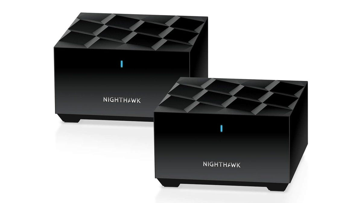 Two cubed shaped Netgear Nighhawk routers.