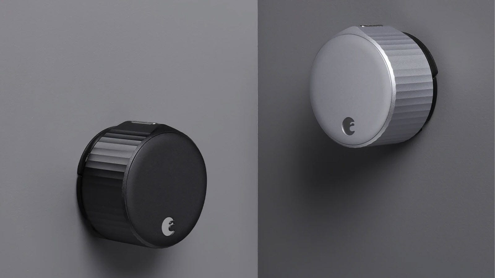 Two August Smart locks in silver and black.