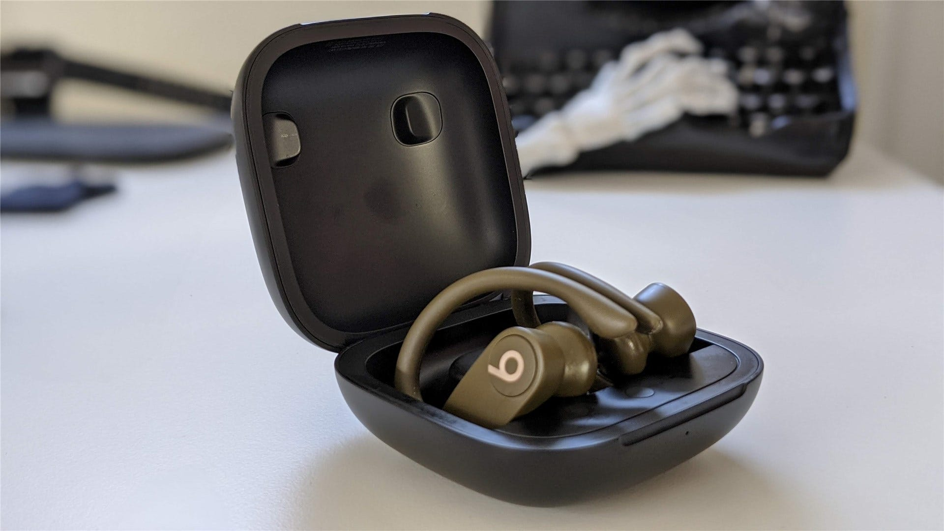 The Powerbeats Pro in the case, open
