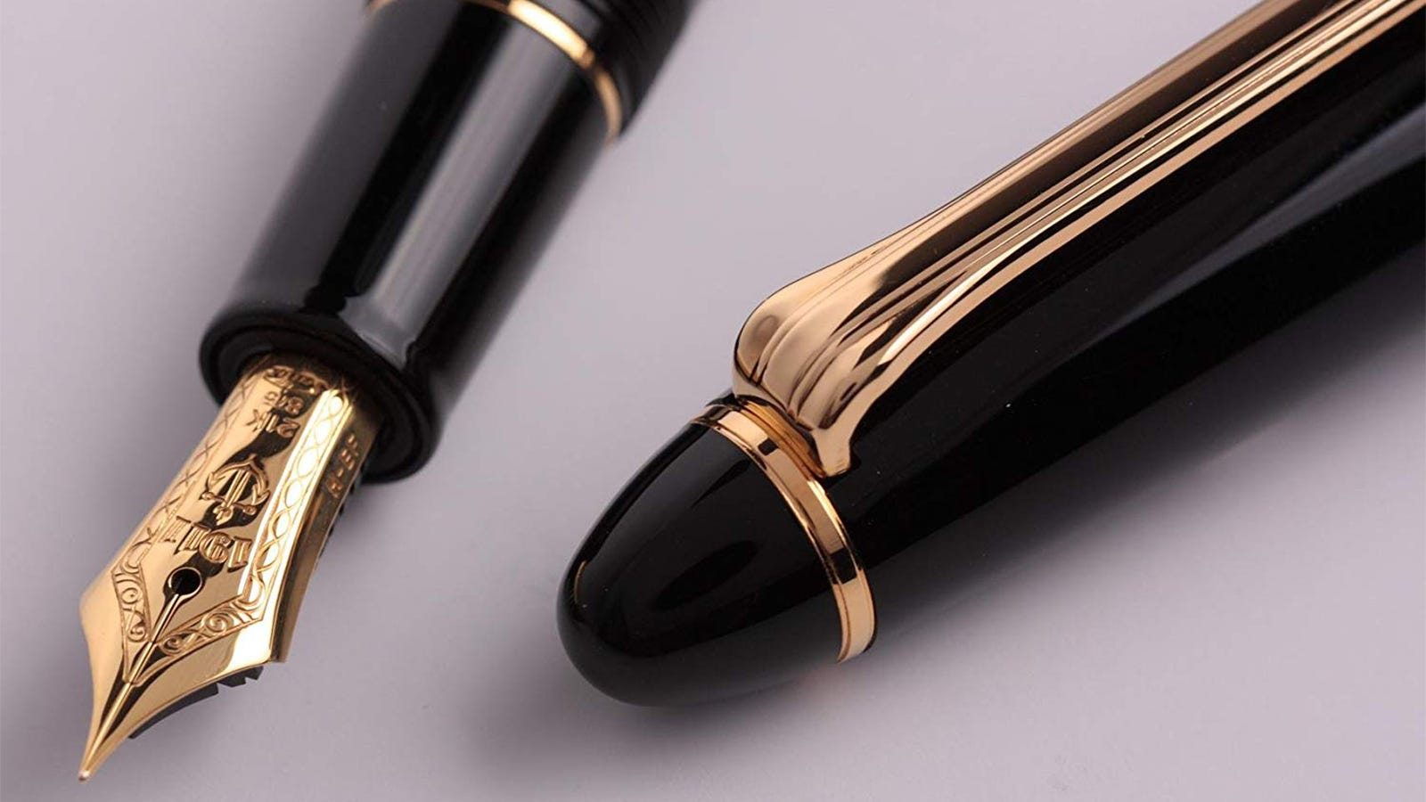 The gold-plated nib and cap of the Sailor Profit Fountain Pen in Black.