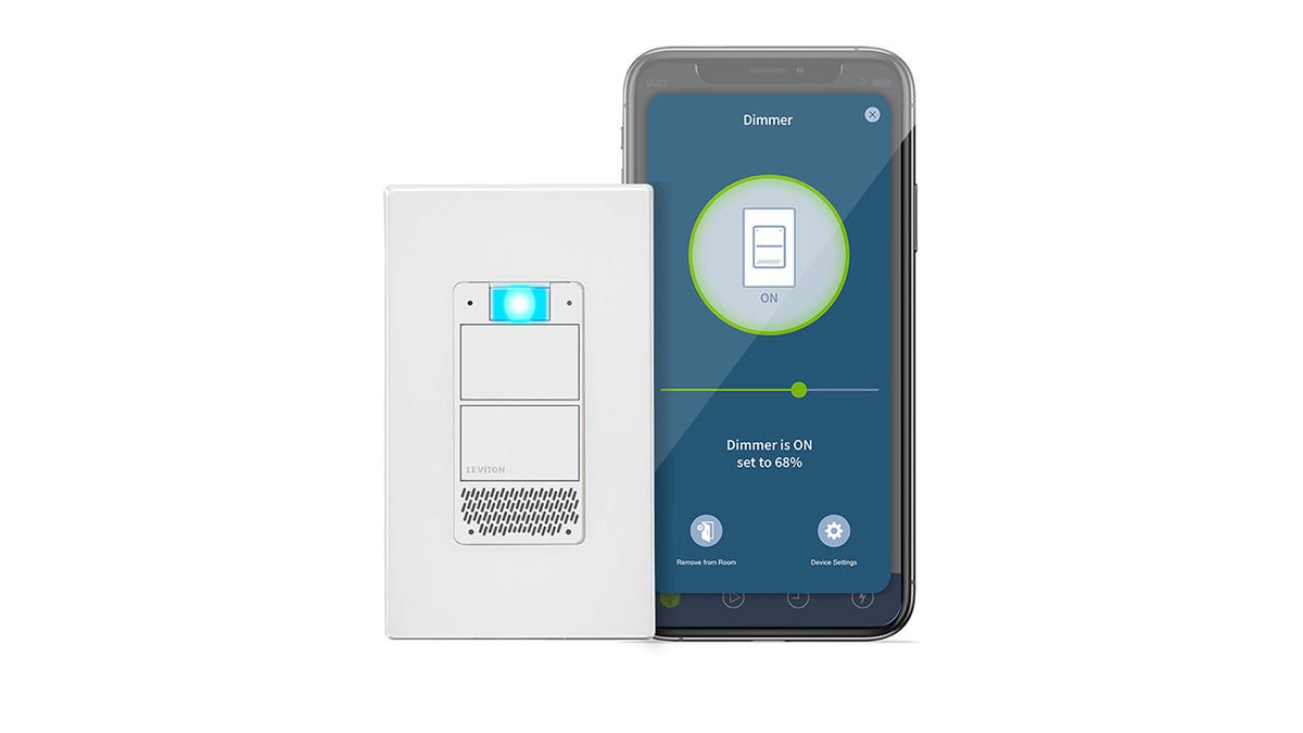 The Leviton Decora Smart Voice Dimmer next to a smart phone with the Leviton app open.