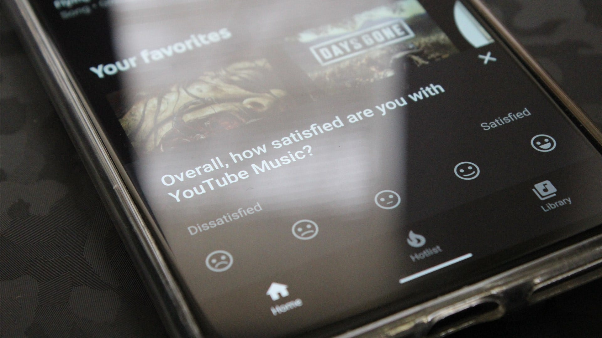 """A """"how satisfied are you with YouTube Music?"""" banner on the Pixel 4 XL"""