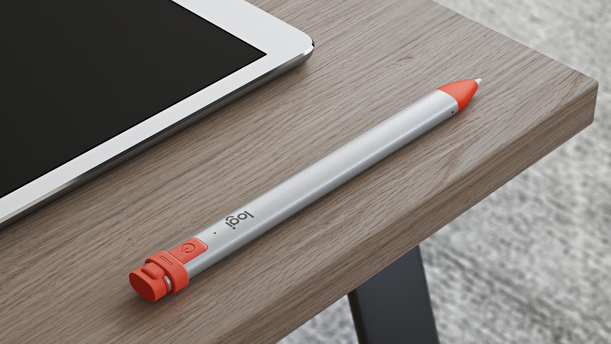 A photo of the Logitech Crayon next to an iPad.