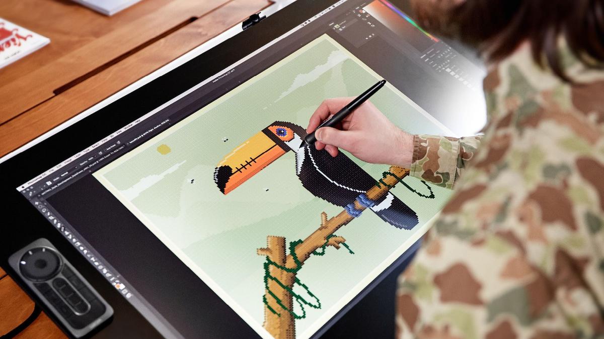 A photo of someone drawing pixel art on the Wacom Cintiq Pro 24