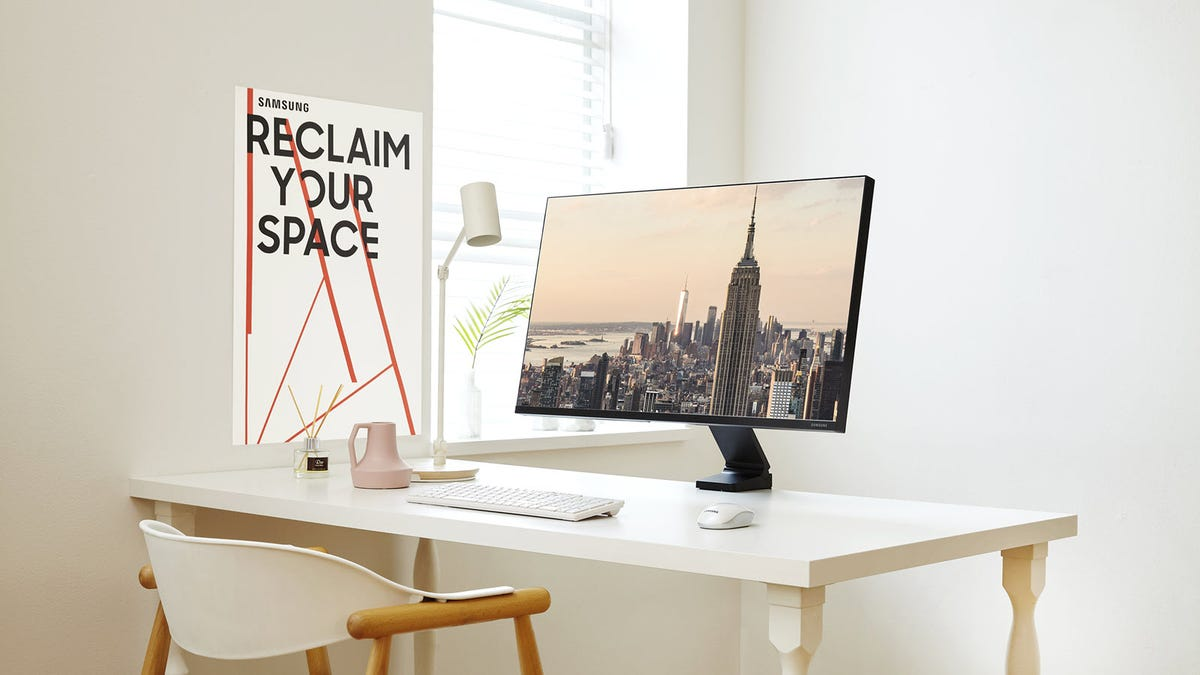 """A Samsung """"The Space"""" monitor, clamped to a desk."""