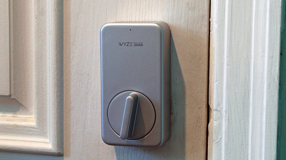 A Wyze smart Lock, with a grey box and a large thumb turn.