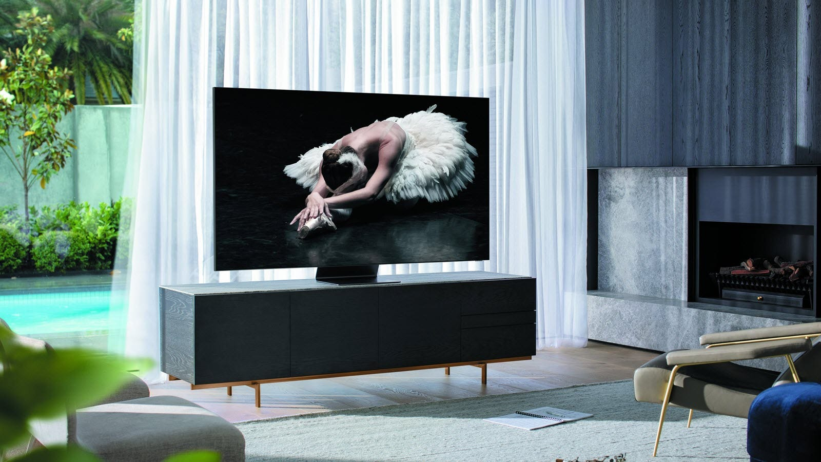 A smaller 8K Q800T on a stand, displaying a ballerina.