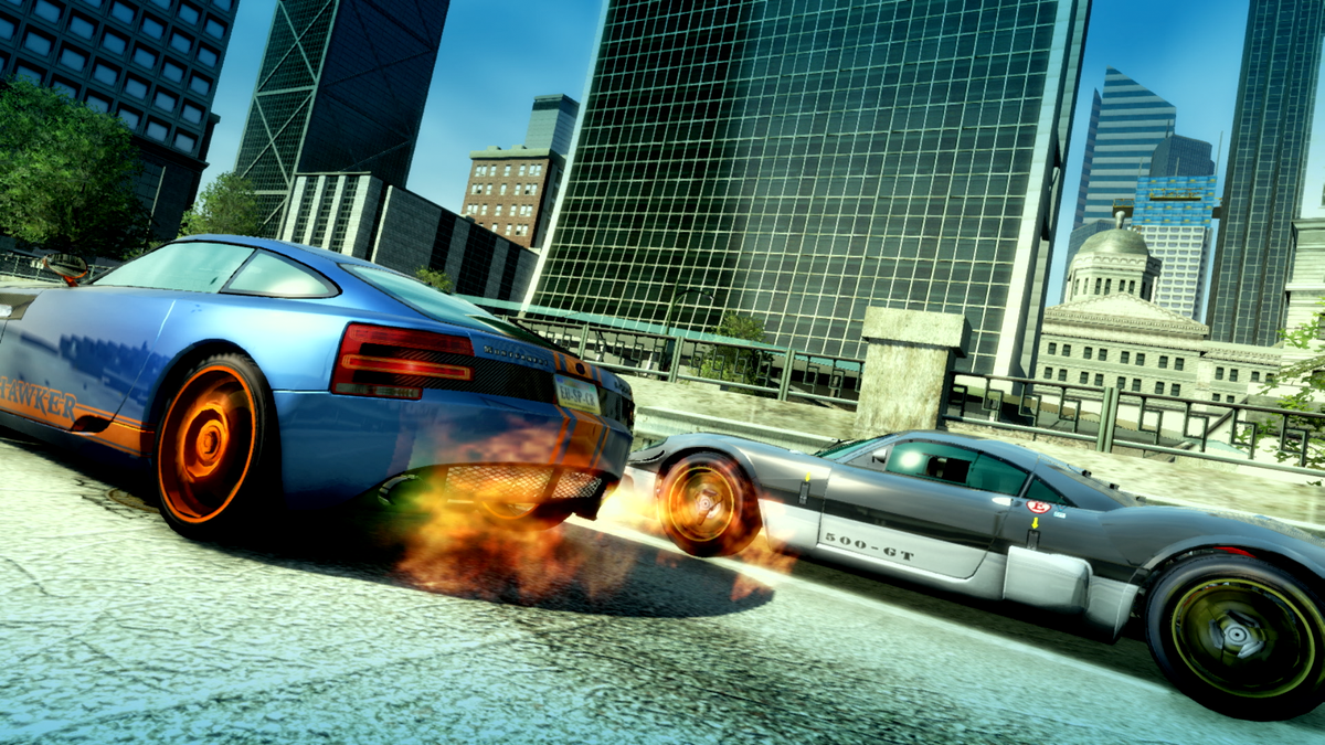 Two cars racing through a city.