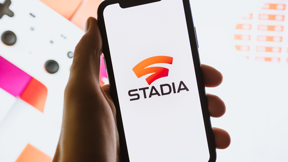 A photo of a phone displaying the Stadia logo.