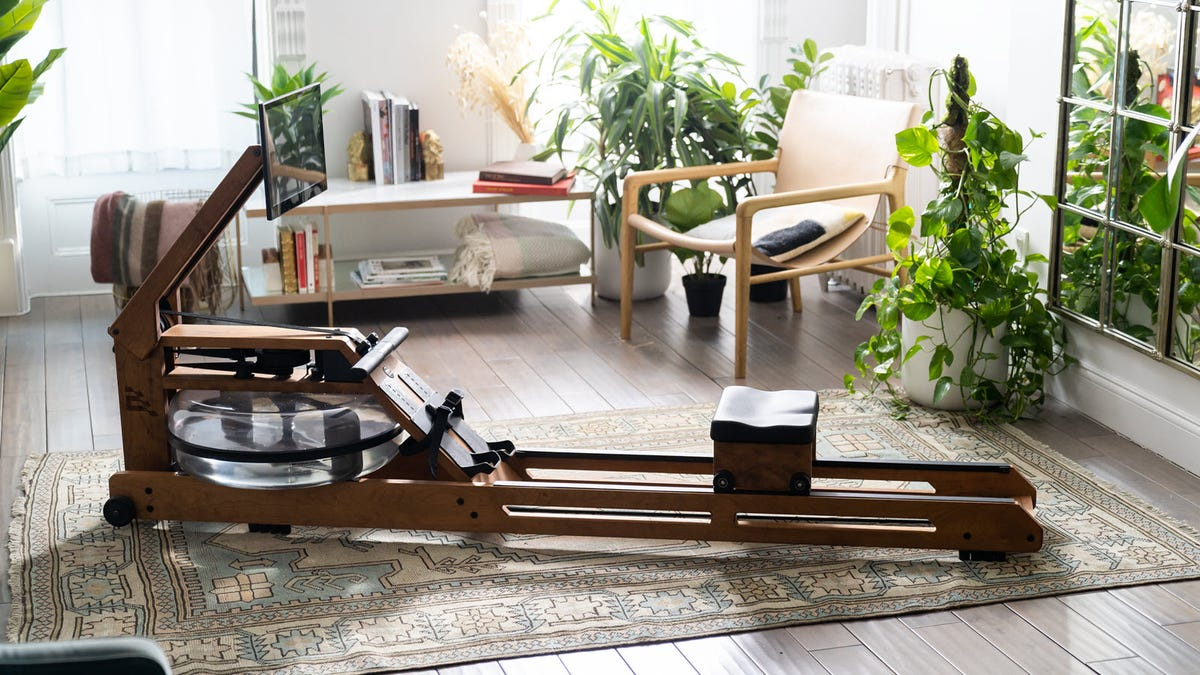 The Ergatta rower, with a wood cherry finish.