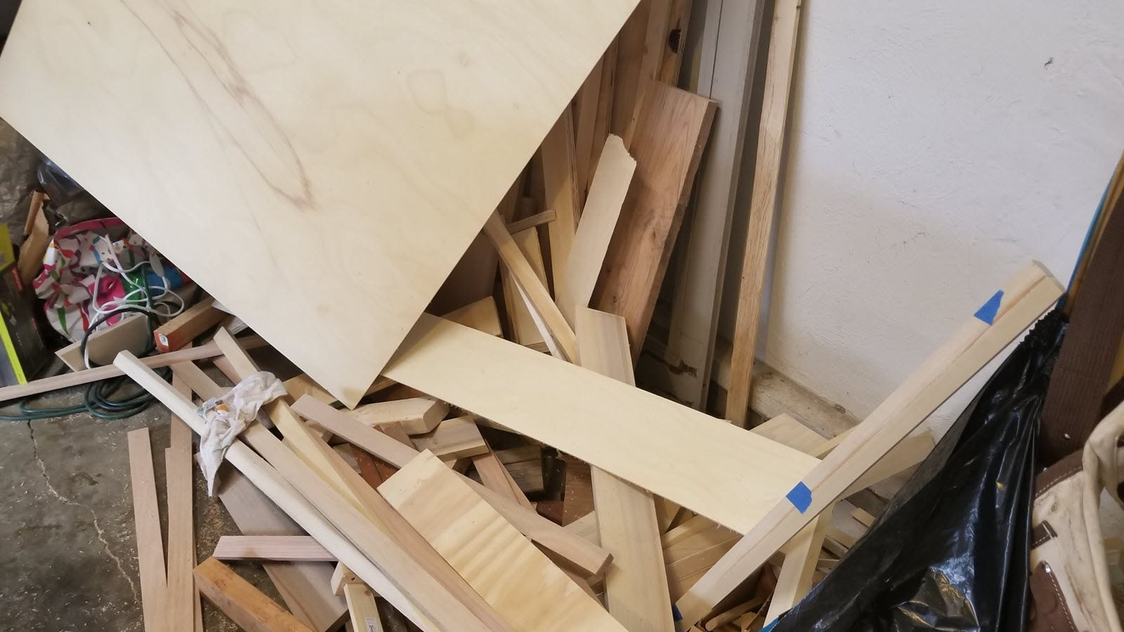 A giant disorganized pile of wood in a nightmarish stack.