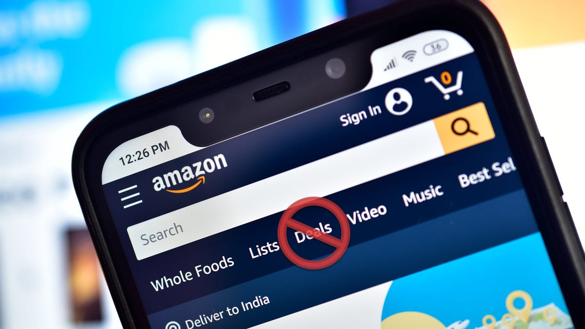 """A closeup of a phone with the Amazon app open and a """"No"""" symbol placed over the Deals entry."""