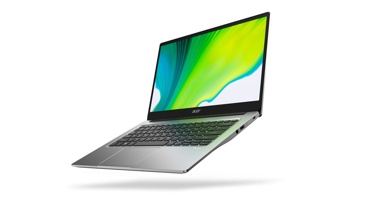 An Acer Swift 4 laptop with swirly green desktop background.