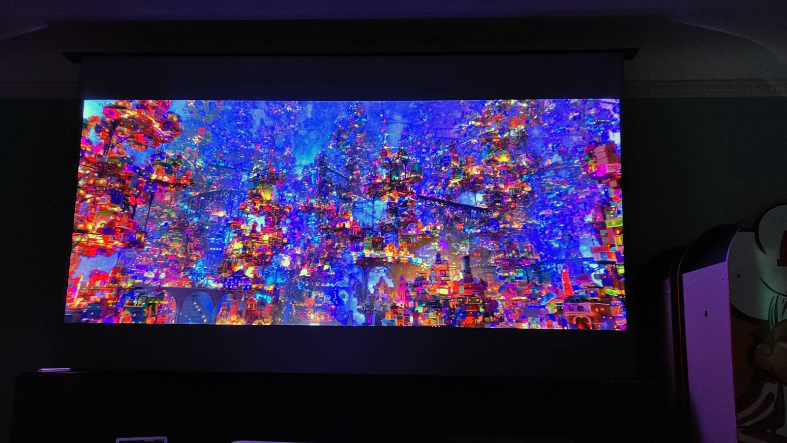 "The massive ghost city form the Pixar movie ""Coco"" on a 100-inch screen."