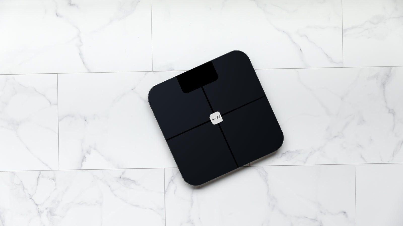 A Wyze Scale on a tile floor.