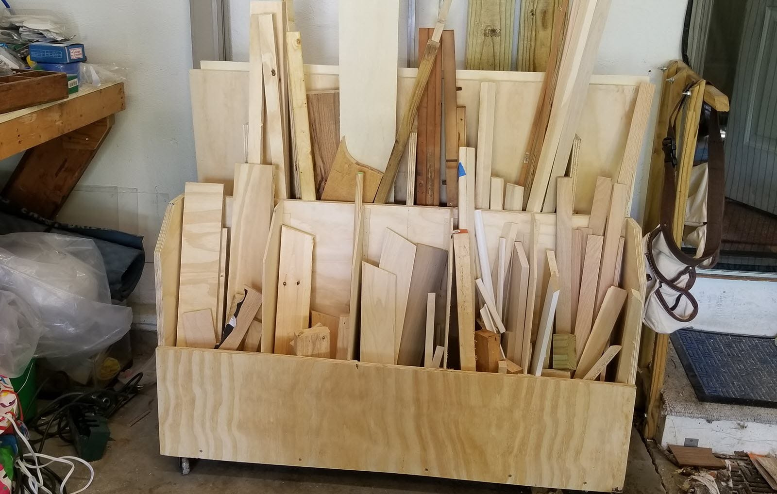 A neatly stacked set of lumber in individual slots of a cart.