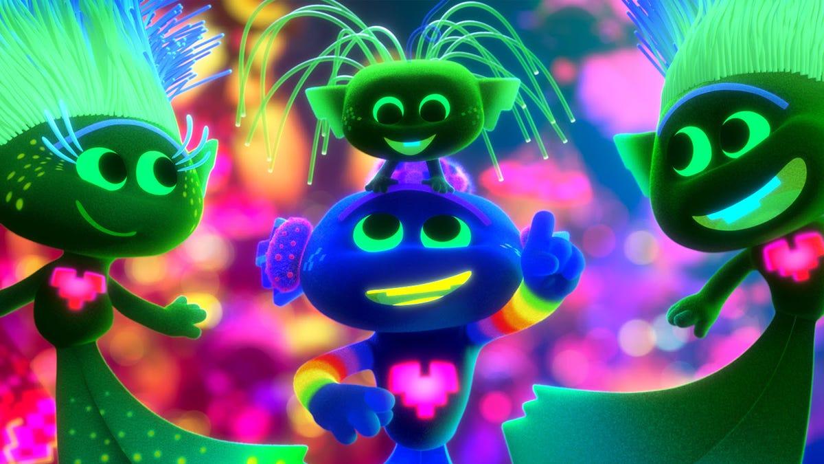 "Four trolls from ""Trolls World Tour"" lit in blacklight neon colors."