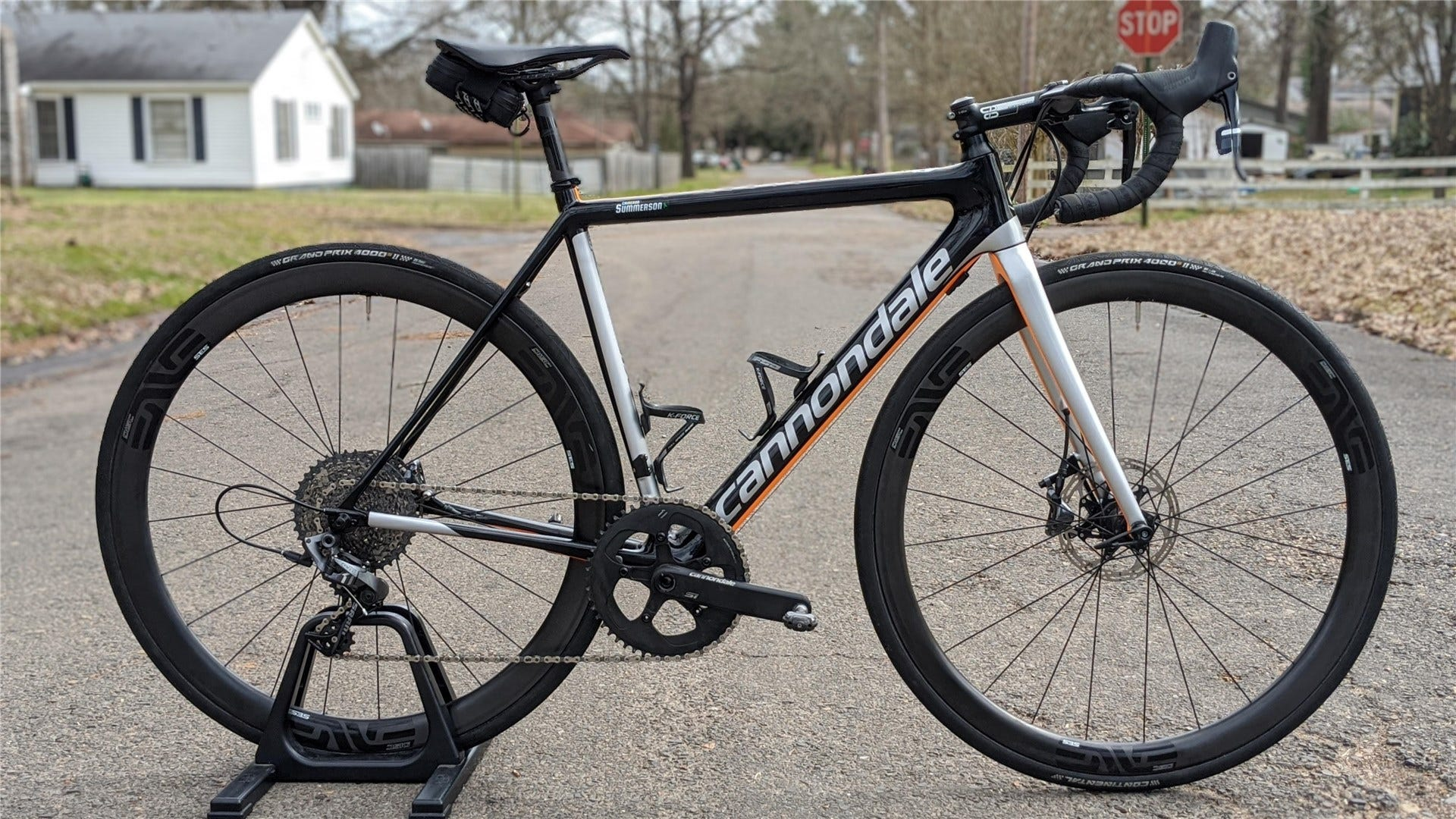 A black/silver/orange Cannondale SuperSix Evo 1x