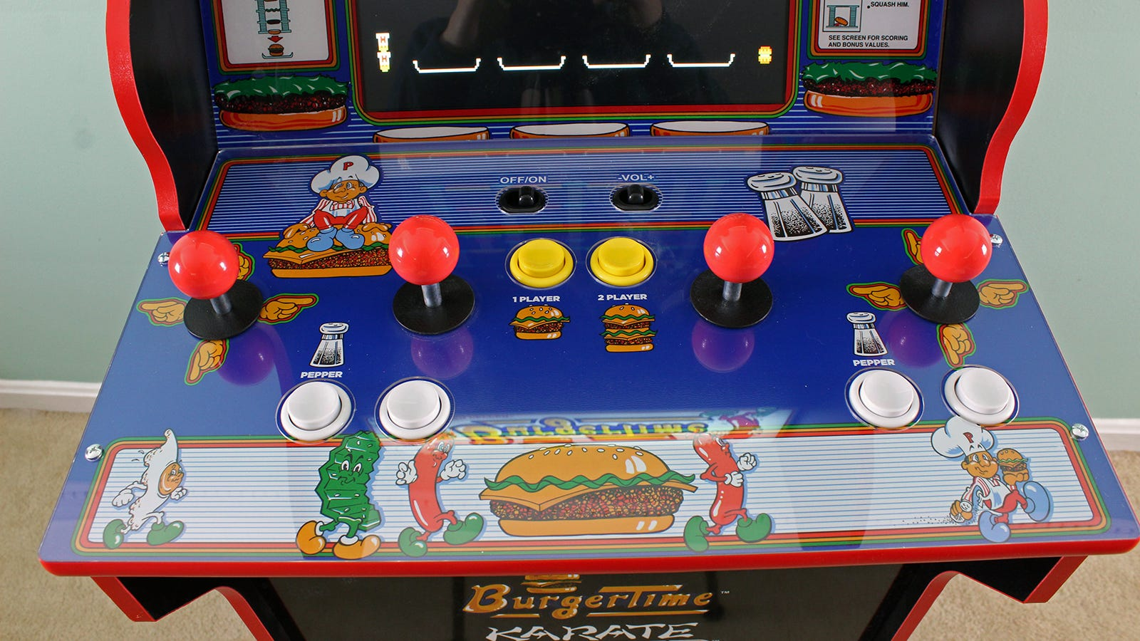 A close up of the control deck showing directional hands around the first and fourth joystick.