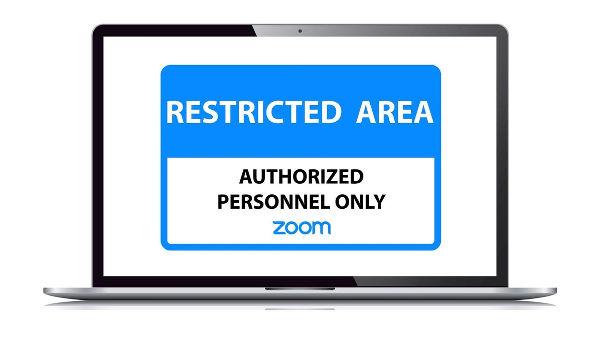 """A Macbook with a """"Restricted access, Authorized personnell only"""" warning and Zoom logo."""