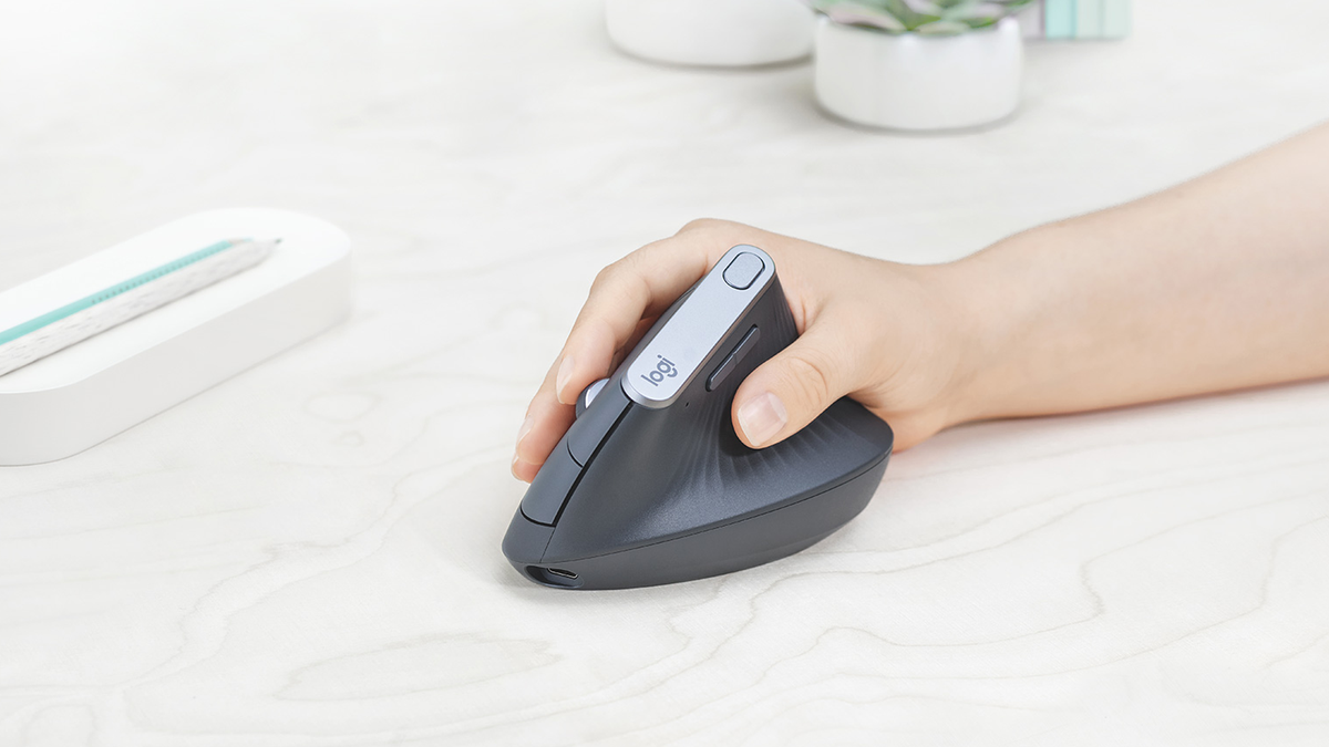 A photo of someone using the Logitech MX Vertical mouse.