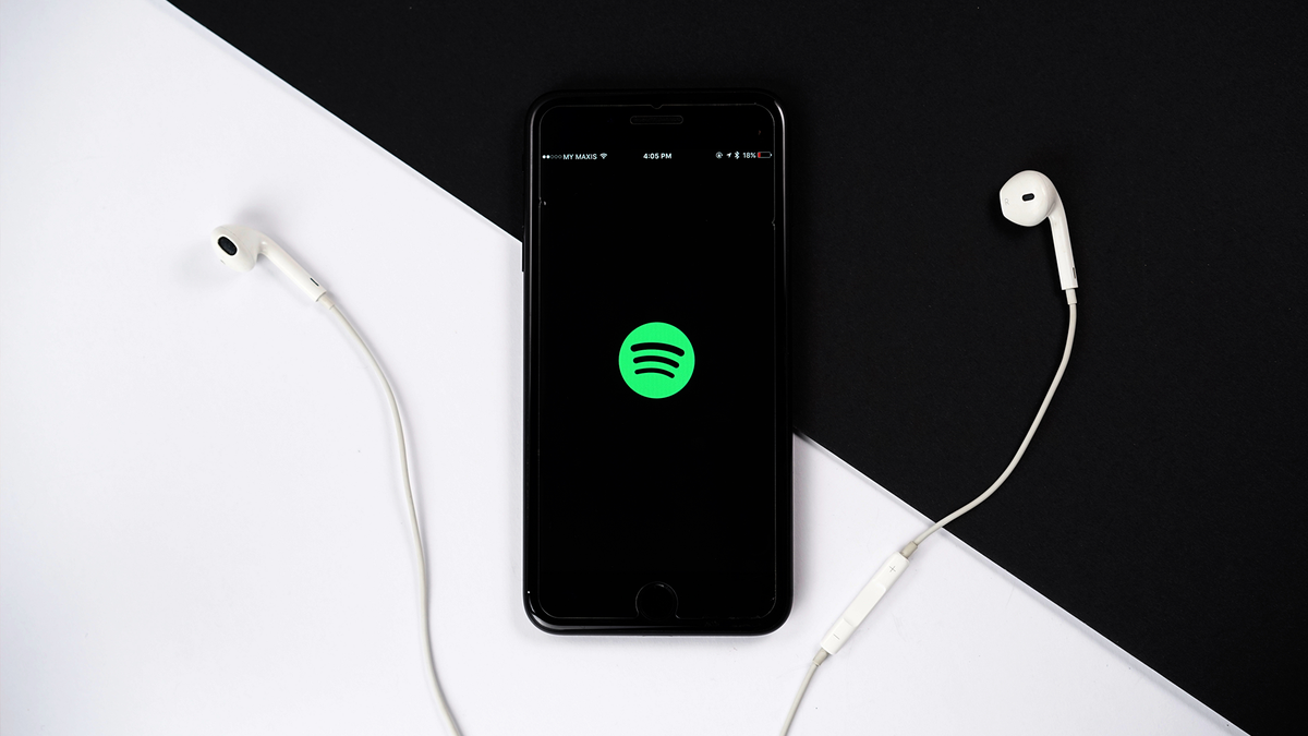 A photo of a phone with the Spotify app open.