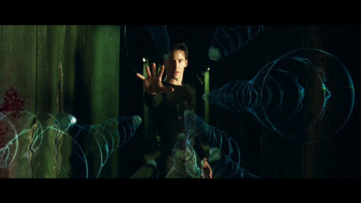 A still of the scene where Neo stops bullets in mid-air.