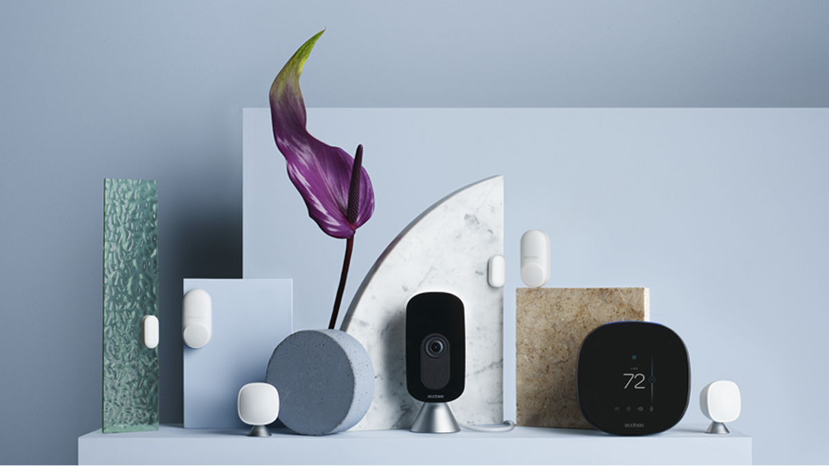 ecobee Smartsensors and camera on a blue pedestal.