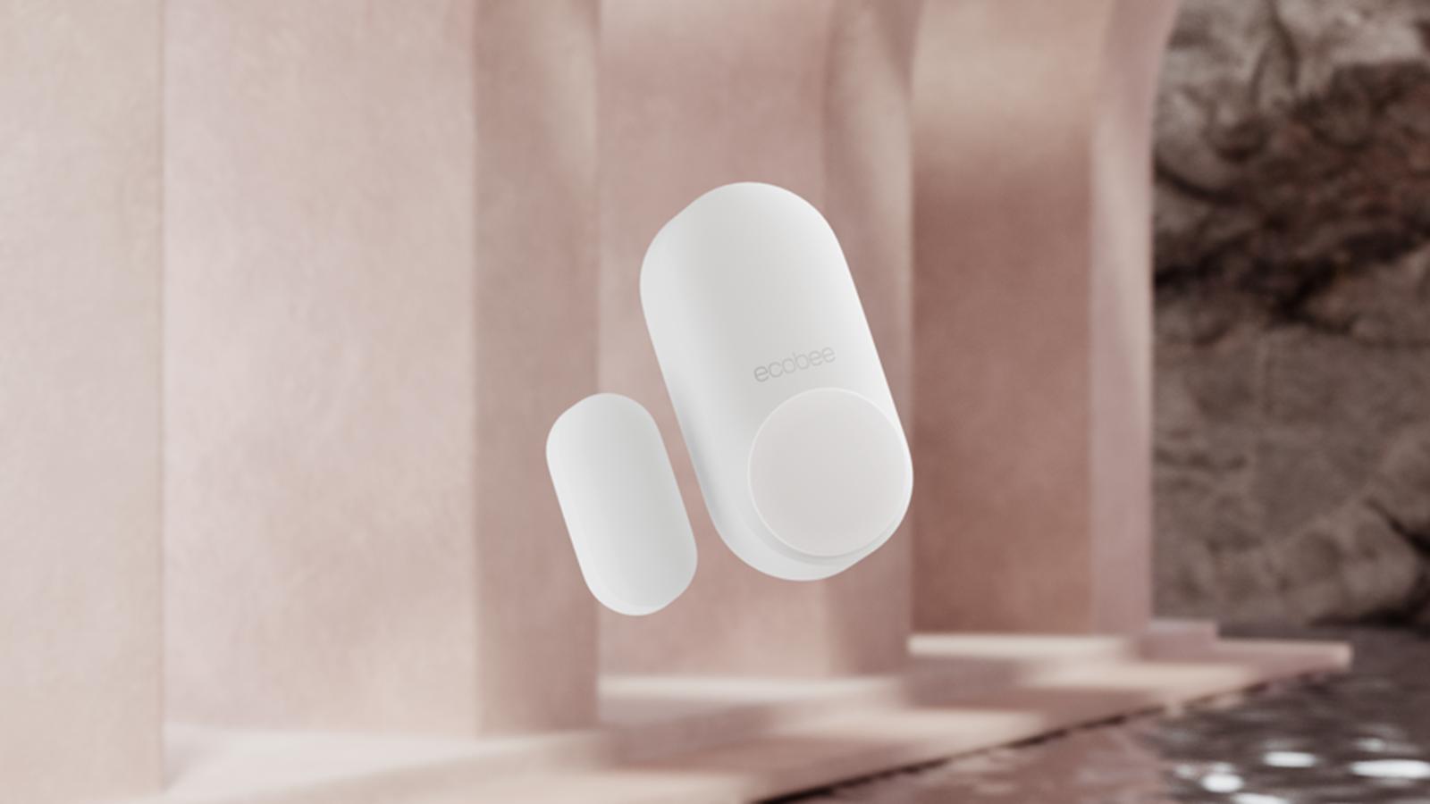 a white ecobee door and window sensor.