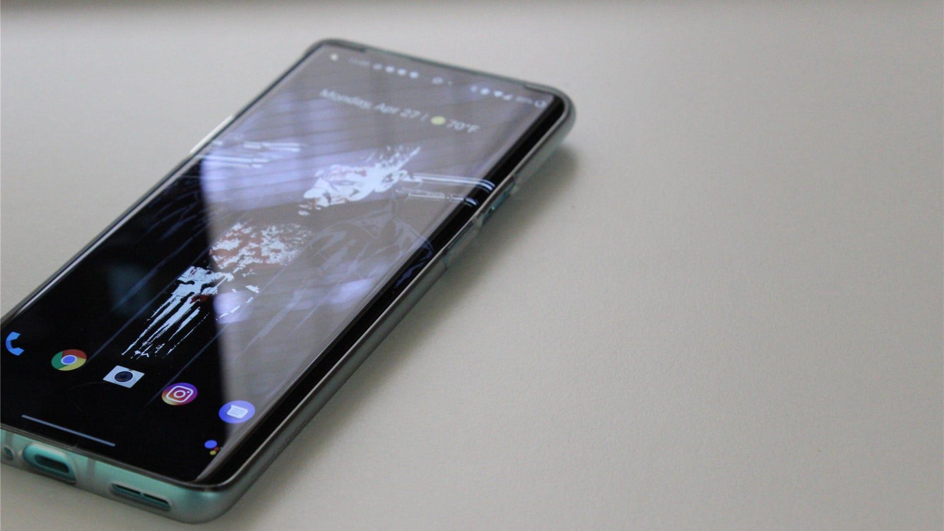 OnePlus 8 Pro lying on a white desk