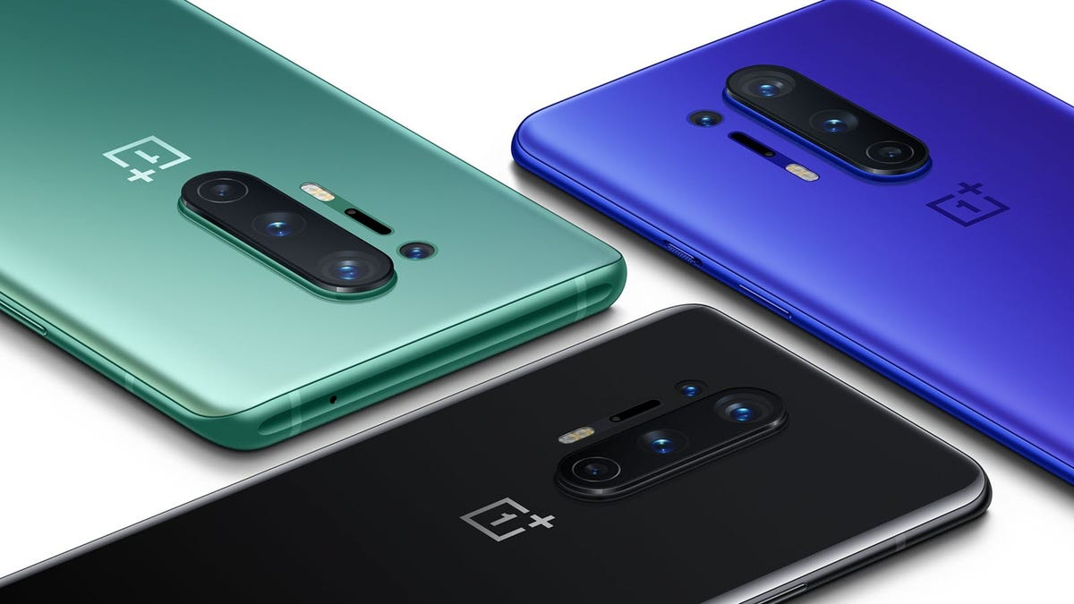 Three OnePlus 8 phones in green, blue, and black.