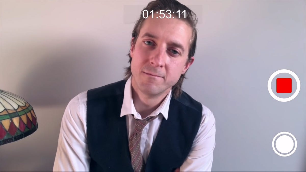 Rory Williams recording a video on a smartphone.