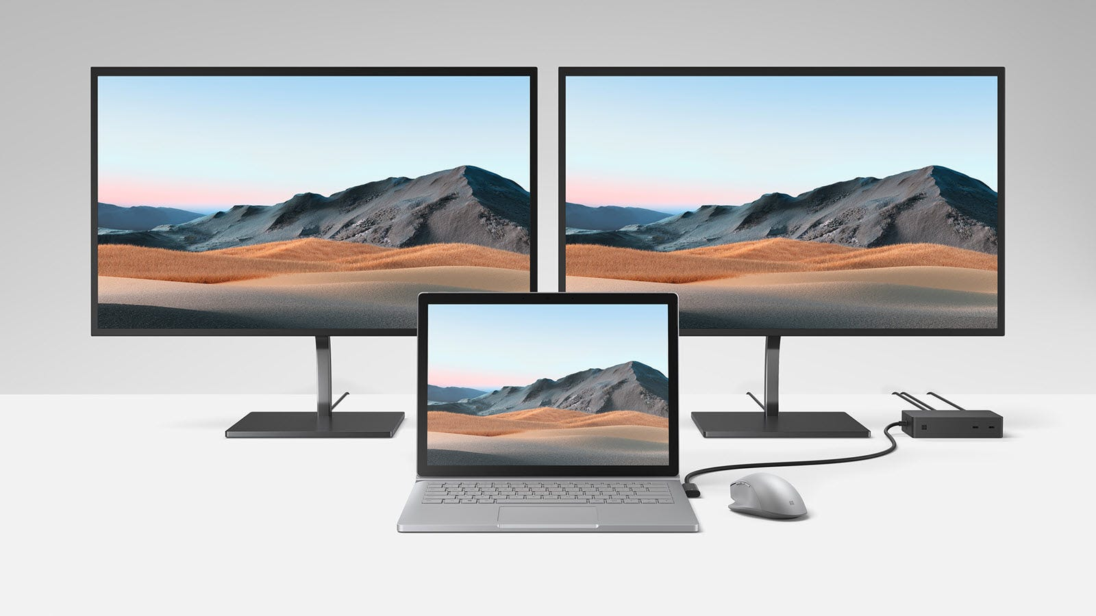 A Surface Book 3 hooked up to two monitors through a Surface Dock 2