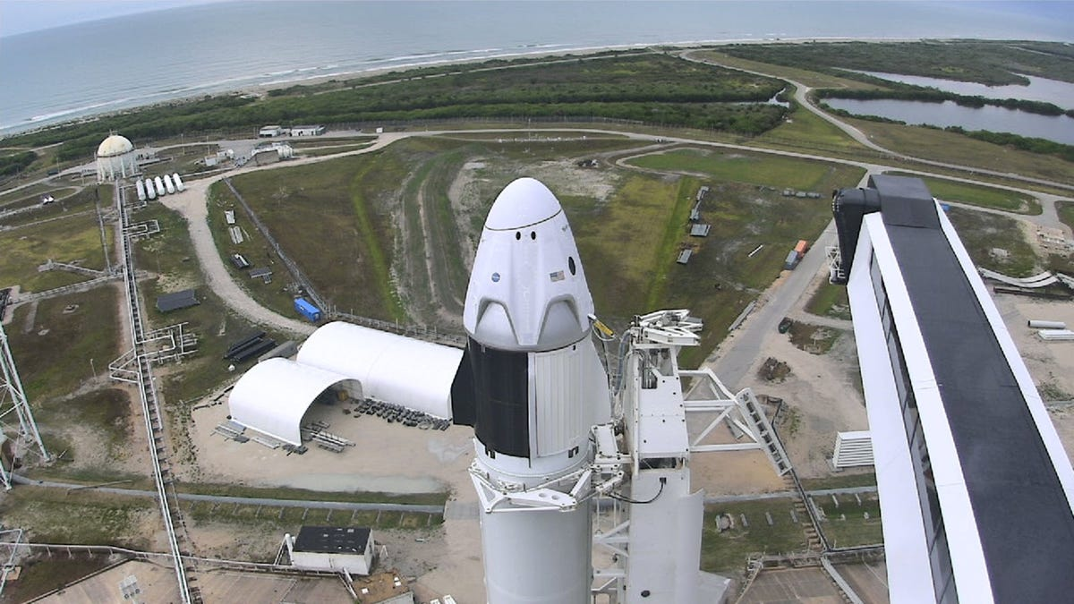 The Falcon 9 rocket in launch position.