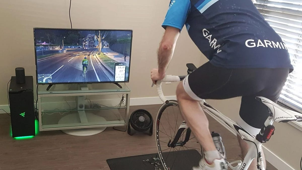 A cyclist on a smart trainer playing GTAV