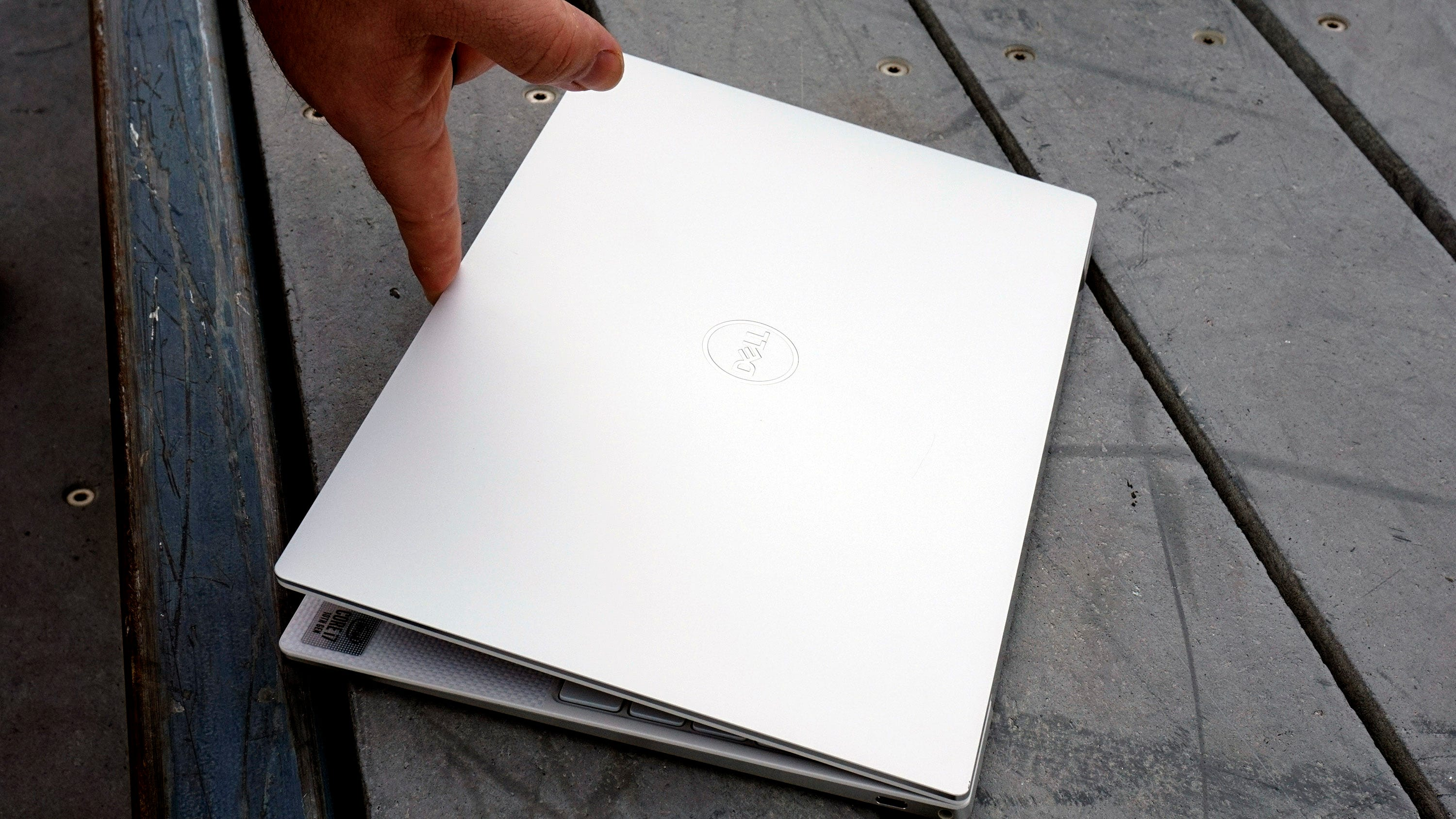 XPS 13 lid opened with one finger.