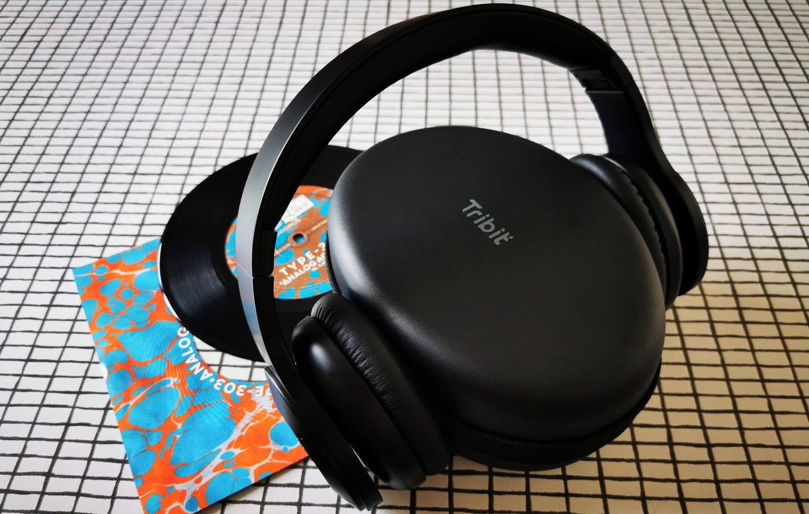 Headphones positioned with cups either side of case