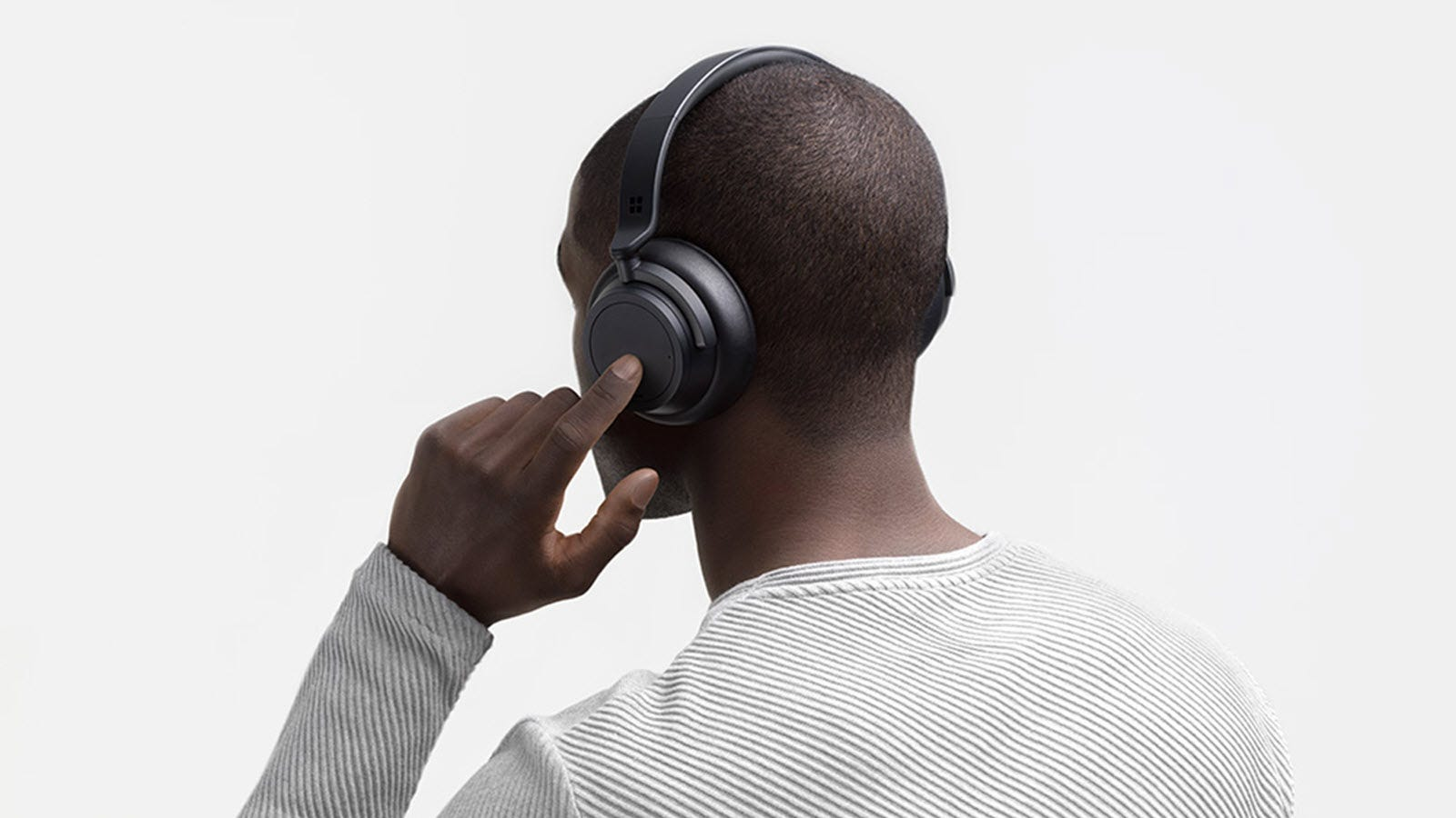 A man wearing a black pair of headphones.