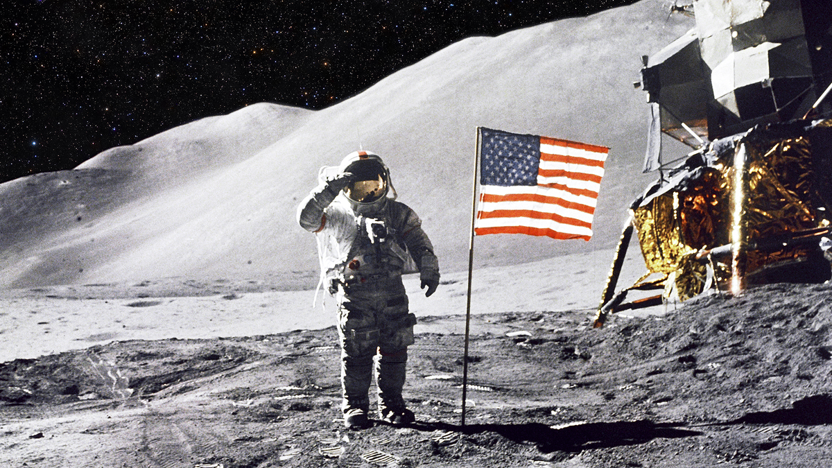 An astronaut on the moon. He's probably holding in a big poop.