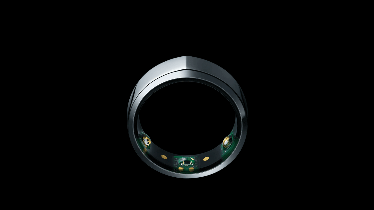 The Oura ring on a black background