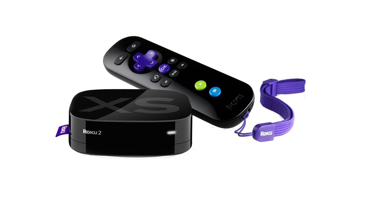 A Roku 2 player next to a Roku remote.