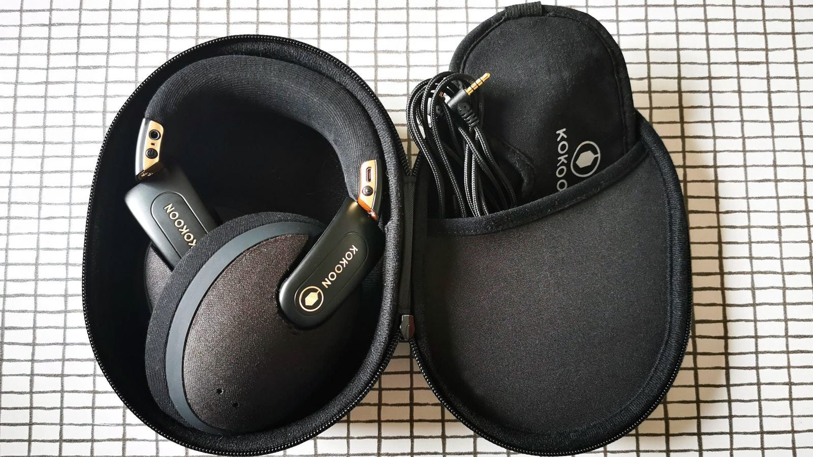 headphones, eye mask and cable in open case