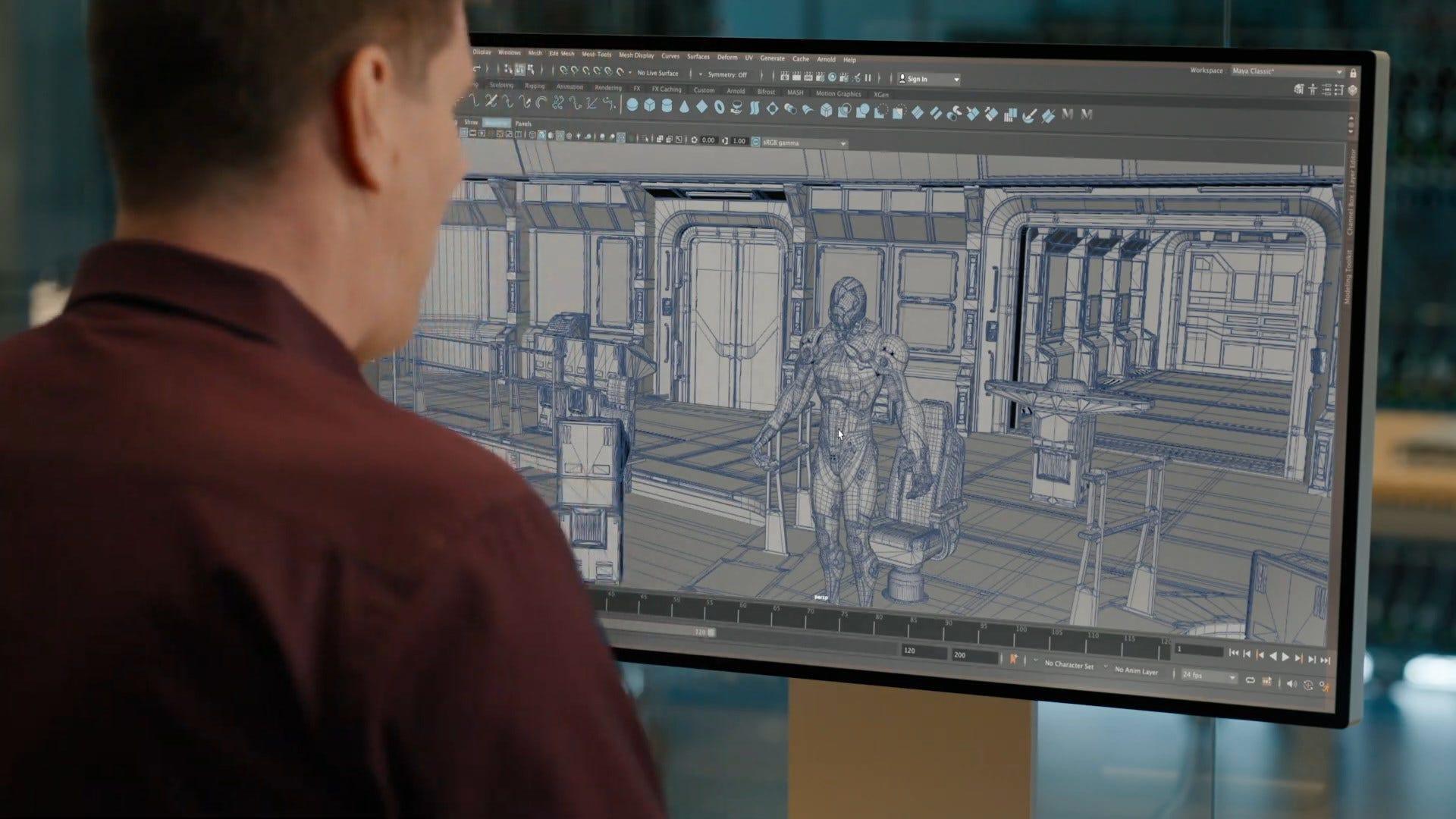Man looks at monitor, an early ARM-based Mac running Maya.