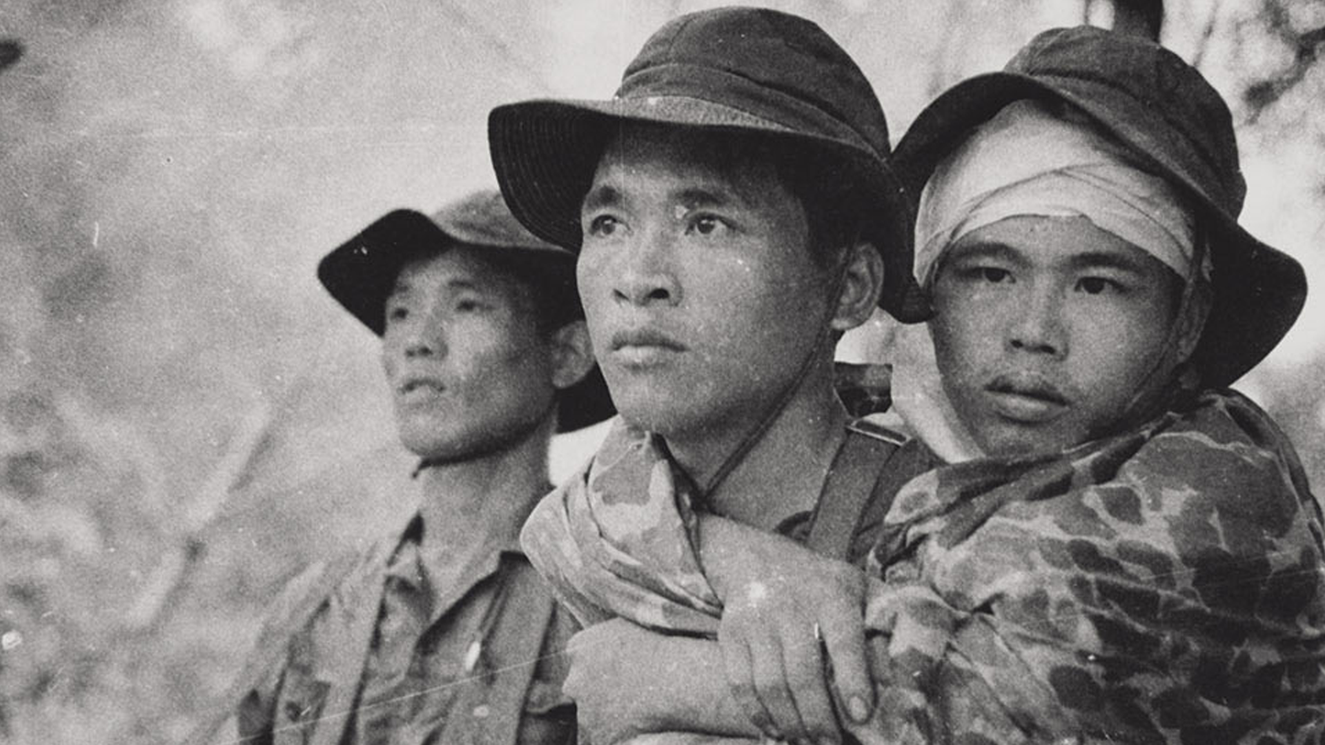 A photo of three young Vietnamese men in fatigues.