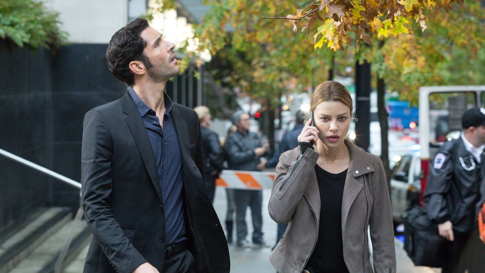 Lucifer and Chloe from the series 'Lucifer' walking down a street.