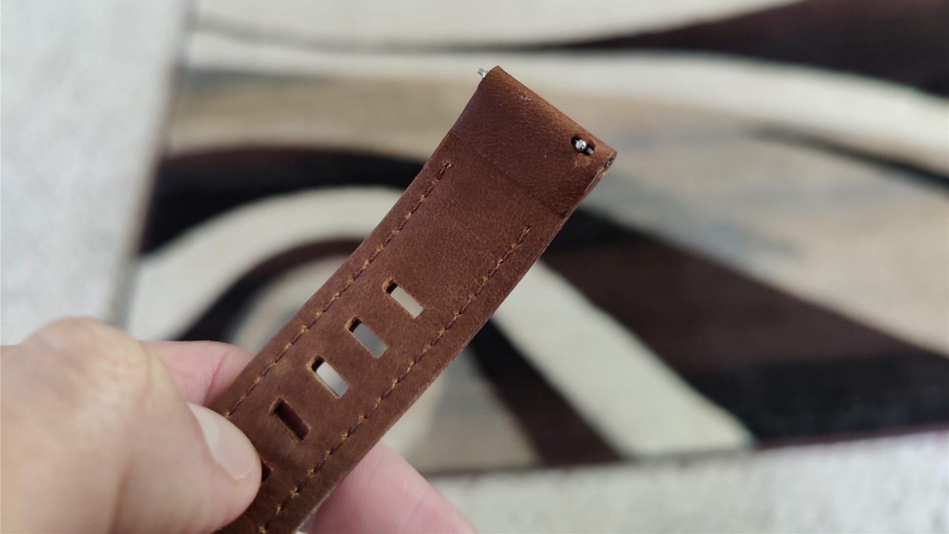 A closeup of the quick switching pins on the leather UAG band