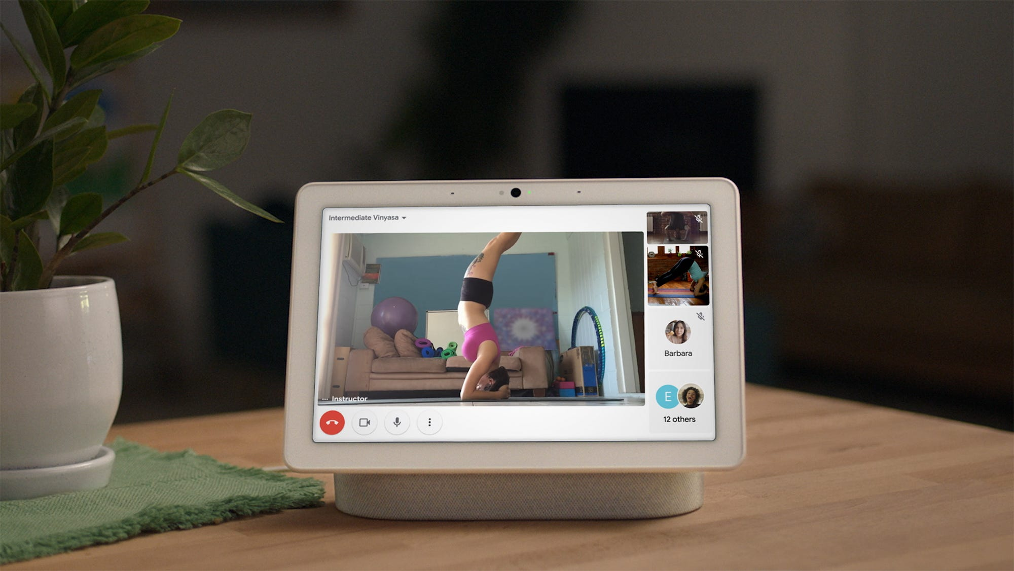 A Google Meet call on a Nest Hub Max with one person doing a handstand.