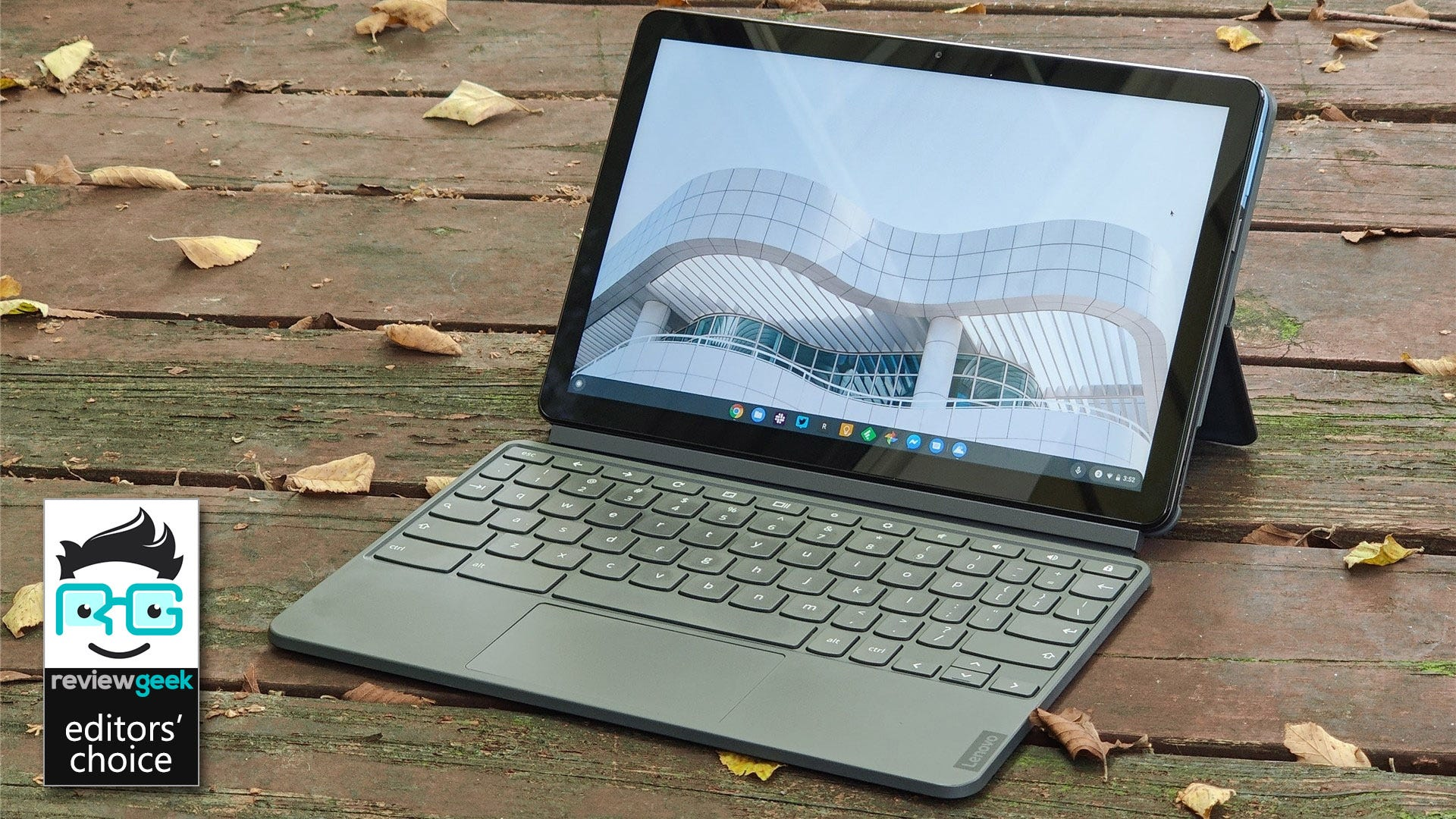 The Lenovo IdeadPad Duet on a wooden deck with leaves all around
