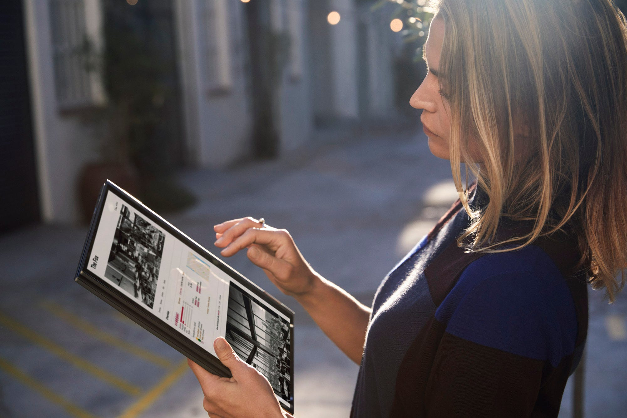 Woman holding Flex 5G in tablet mode